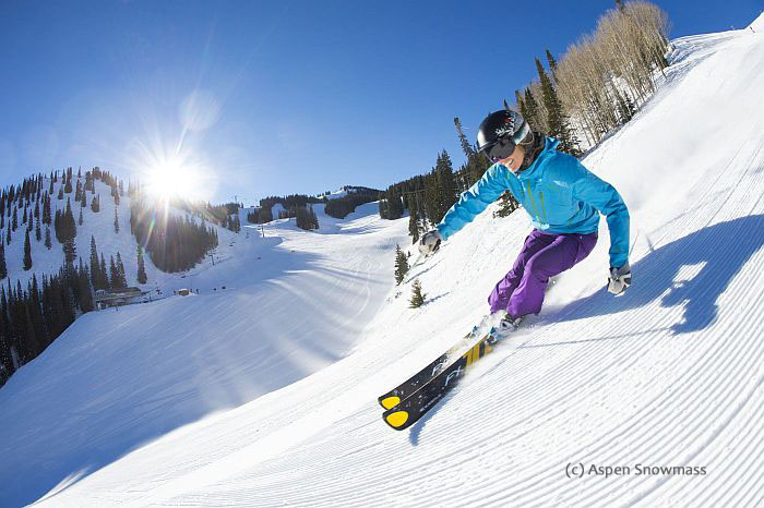 A Woman Skiing Groomers